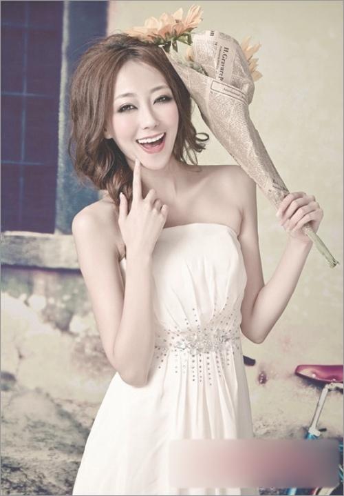娃娃脸新娘发型设计 尽显可爱迷人气质_妆面赏析_影楼