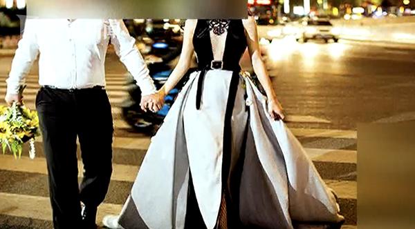 新人斑马线上拍婚纱照摆造型 来往车辆被逼停