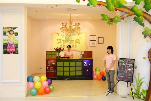 西瓜庄园儿童摄影 西瓜庄园儿童摄影门店装修设计展示:五角场百联店