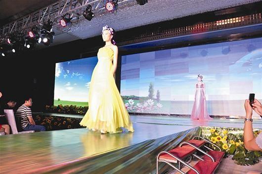 最新影楼资讯新闻-旺季将至 彩色婚纱成武汉商家热推重点