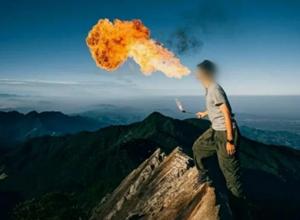 """最新影楼资讯新闻-台湾一摄影师山顶玩""""喷火"""",岛内""""火了"""":最高罚60万新台币"""